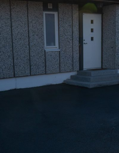 asfaltering av uteområde ved bolig