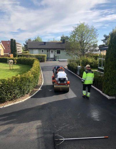 asfaltering av innkjørsel til bolig